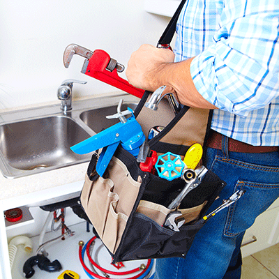 plumbing at a kitchen sink for maintenance